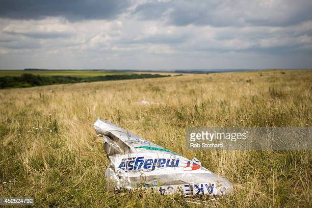 Wreckage from Malaysia Airlines flight MH17 lies in a field on July 22 2014 in Grabovo Ukraine Malaysia Airlines flight MH17 was travelling from...