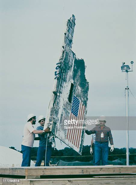 Wreckage from the Space Shuttle Challenger being lowered into an abandoned Minuteman Missile Silo at Complex 31 on Cape Canaveral Air Force Station...