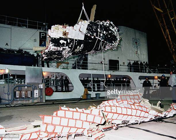 Wreckage from the Space Shuttle Challenger retrieved from the Atlantic Ocean returned to the Trident Basin at Cape Canaveral Air Force station aboard...