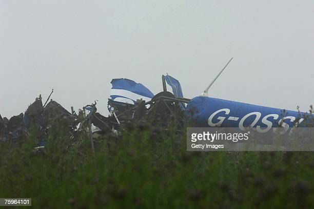 Wreckage is strewn across a field at the scene of a fatal helicopter crash in Gatebeck Cumbria England on 4 August 2007 Four people were killed in...
