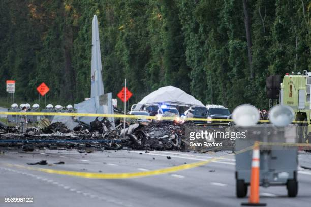 Wreckage is strewn across Route 21 where an Air National Guard C130 cargo plane crashed May 2 2018 in Port Wentworth Georgia The 50yearold plane...