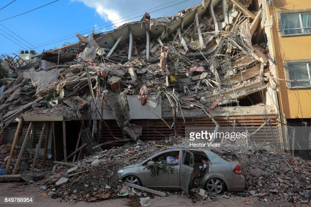 Wreckage of a building knocked down by a magnitude 71 earthquake that jolted central Mexico damaging buildings knocking out power and causing alarm...