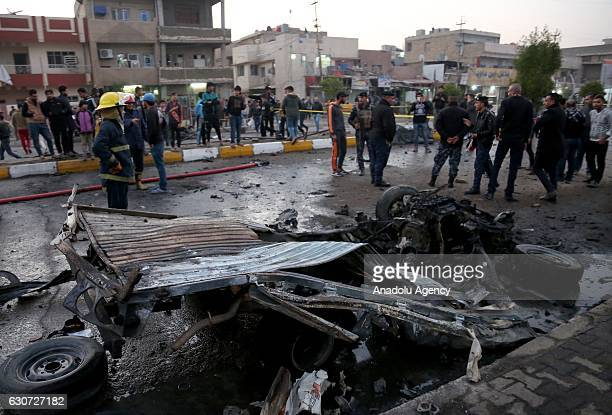 A wreckage of a car is seen after a car bomb attack at elCedide street in Baghdad Iraq on December 31 2016
