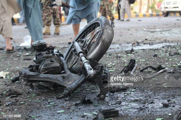 Wreckage of a vehicle is seen after a suicide bomb attack in Afghanistan's western city of Herat on August 9 2018 At least 4 killed and 12 people...