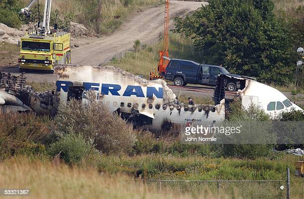 Wreckage of Air France flight 358 is seen at Pearson International Airport August 3 2005 in Toronto Ontario Canada All 309 passengers and crew...