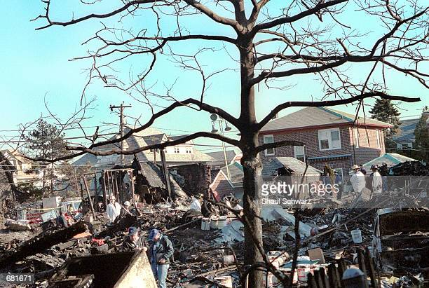 Wreckage of American Airlines flight 587 lays scattered among destroyed houses November 13 2001 in the Rockaway section of Queens New York Mechanical...