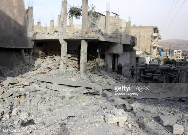 Wreckage of buildings are seen after Assad Regime's forces carried out air strikes over the deconflict zone at the Jisr alShughur district of Idlib...