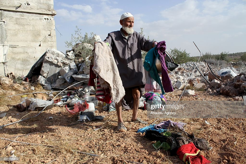 Wreckage of buildings are seen at the site of the alleged Russian airstrikes targeting the Jabal al-Zawiya town of Idlib, Syria on October 03, 2015.