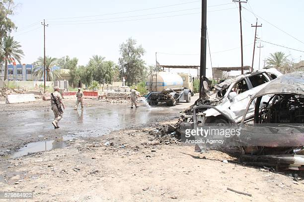 Wreckage of cars are seen after a suicide bomber drove his explosiveladen vehicle into a crowded checkpoint at the eastern entrance of Khalis...