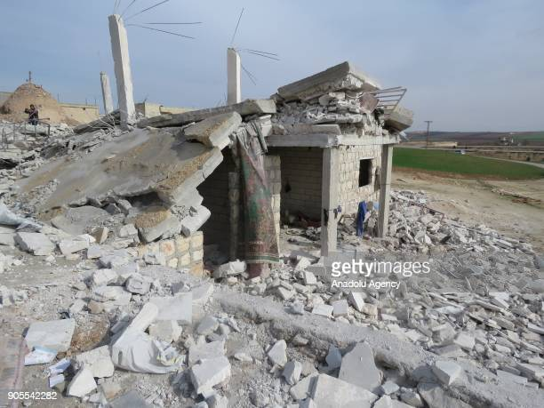 Wreckage of houses are seen after an airstrike to Khan Shaykhun in Idlib Syria on January 16 2018