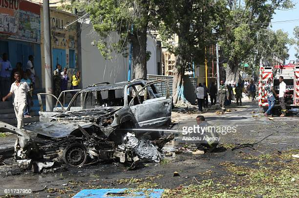 Wreckage of vehicle at the site of a car bomb attack near a restaurant in Somalia's capital Mogadishu on August 25 2016