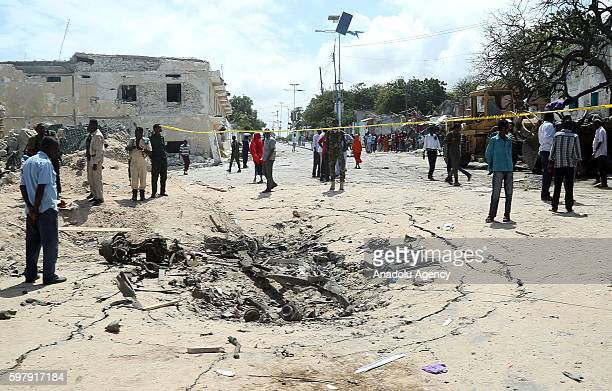 Wreckage of vehicles are seen at the site of a car bomb attack near a Presidental Palace at SYL Hotel in Somalia's capital Mogadishu on August 30 2016