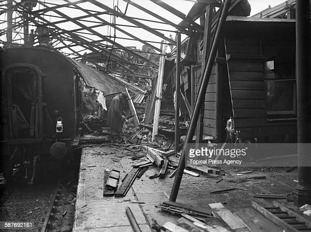 Wreckage piled up at Bletchley railway station Buckinghamshire the day after the Night Scot train of the London Midland and Scottish Railway passed a...