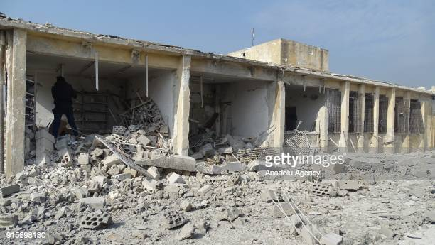 Wreckages of a building is seen after Russian airstrikes hit Mishmishan village of Idlib's Jisr alShughur district in Syria on February 07 2018...