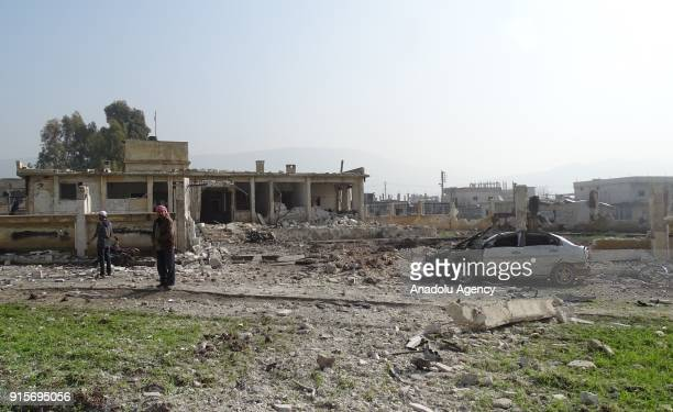 Wreckages of buildings and a car are seen after Russian airstrikes hit Mishmishan village of Idlib's Jisr alShughur district in Syria on February 07...