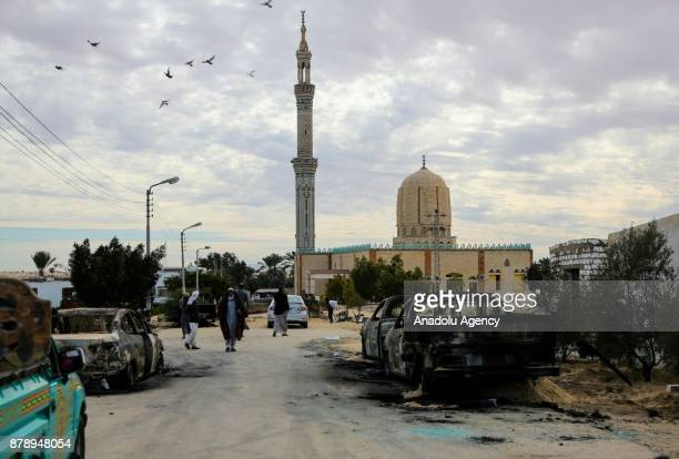 Wreckages of cars are seen after the Egypt Sinai mosque bombing in AlArish Egypt on November 25 2017 The death toll in the attack on a mosque in...