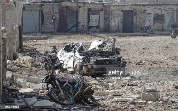 Wreckages of motorcycles and a car are seen after Russian airstrikes hit Mishmishan village of Idlib's Jisr alShughur district in Syria on February...