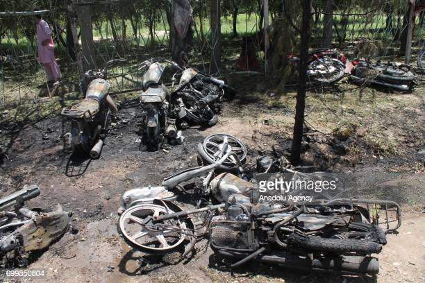 Wreckages of motorcycles are seen after a suicide car bomb attack outside a staterun bank in southern Afghan province of Helmand Afghanistan on June...