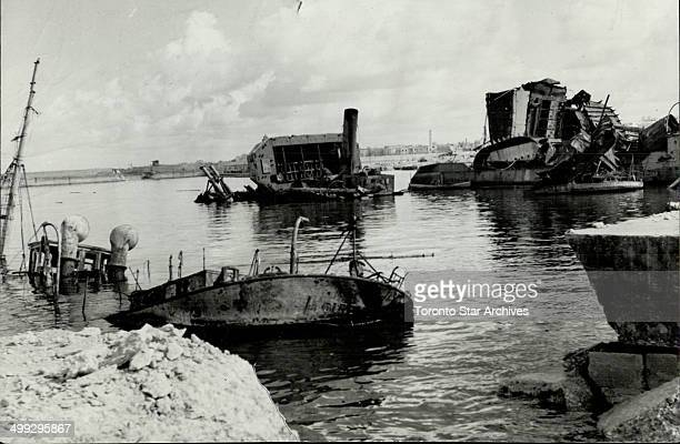 Wrecked axis ships pounded from the air and sea littered Bengazi harbor when General Alexander's Eighty Army arrived close behind the retreating...