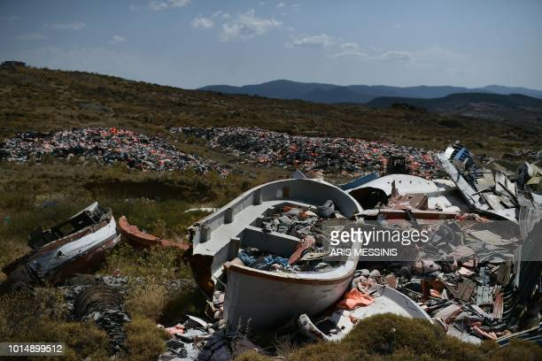 Wrecked boats and thousands of life jackets used by refugees and migrants during their journey across the Aegean sea lie in a dump in Mithymna on the...
