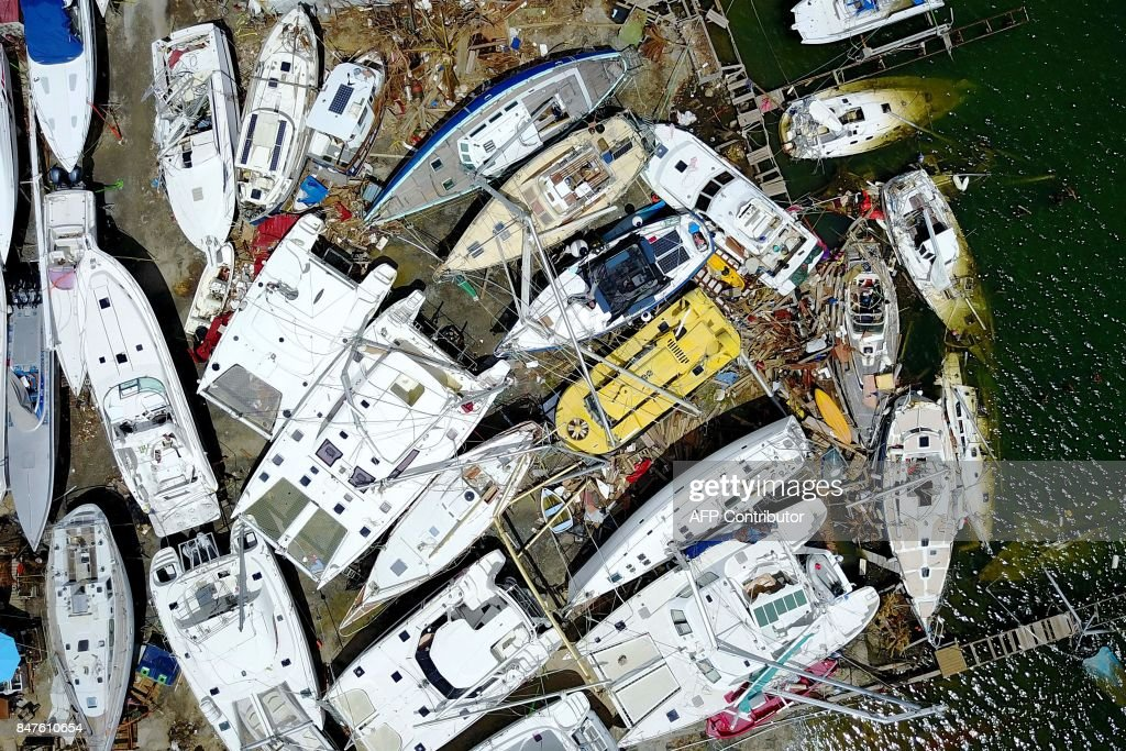 TOPSHOT - Wrecked boats are seen days after this Caribbean island sustained extensive damage in the wake of Hurricane Irma in St. Martin, Friday, September 15, 2017. / AFP PHOTO / Ricardo ARDUENGO