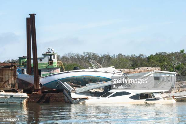 wrecked boats destroyed by hurricanes in fernandina beach florida - 2016 hurricane matthew stock photos and pictures
