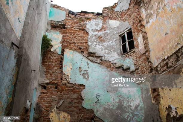 Wrecked building showing traces of floorsi starirs and walls, Tarlabas, Istanbul Taksim
