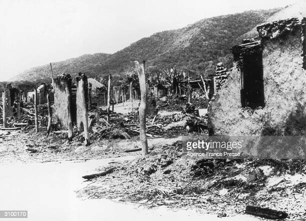 Wrecked buildings in the township of Quessala Angola 5th April 1961 after it was attacked by rebel forces during the guerilla war against Portuguese...