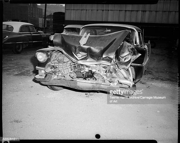 Wrecked Cadillac car belonging to Walt Harper with extensive front end damage Pittsburgh Pennsylvania November 1956