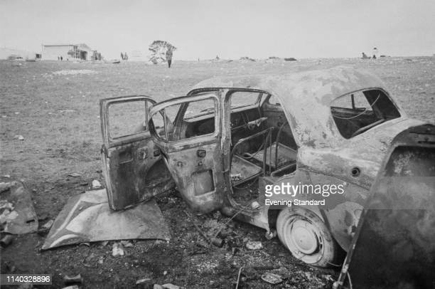 A wrecked car at the Isle of Wight Festival Wootton UK 31st August 1969