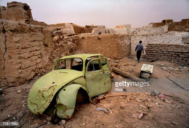 A wrecked car stands abandoned in ruins of the old town in April 2000 in Ghadames Libya