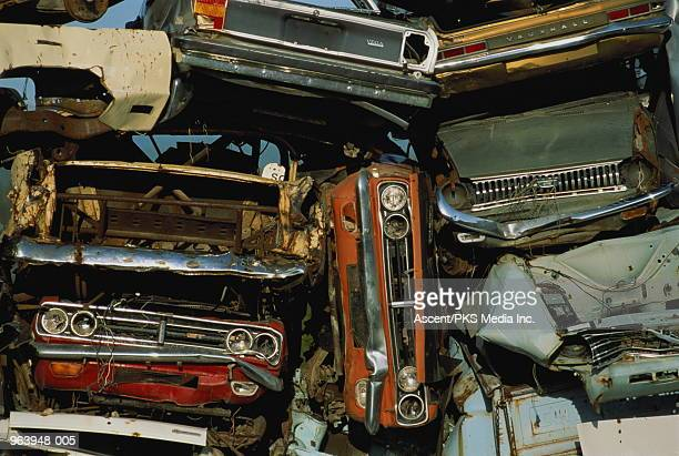 wrecked cars in scrapyard, full frame - junkyard stock photos and pictures