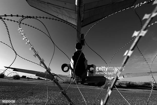 Wrecked Cyprus Airways plane sits behind barbed wires on the tarmac of the abandoned Nicosia airport in the UN-protected area of the divided Cypriot...