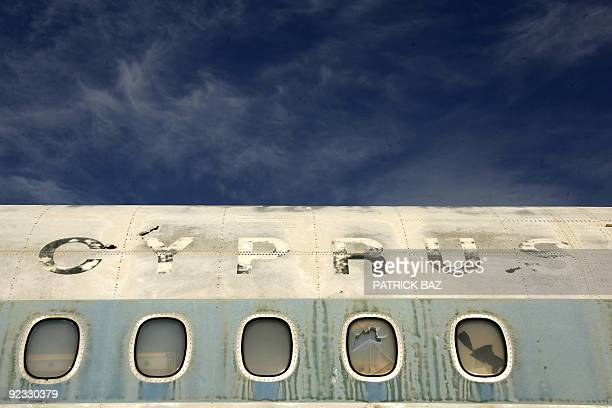 Wrecked Cyprus Airways plane sits on the tarmac of the abandoned Nicosia airport in the UN-protected area of the divided Cypriot capital on October...