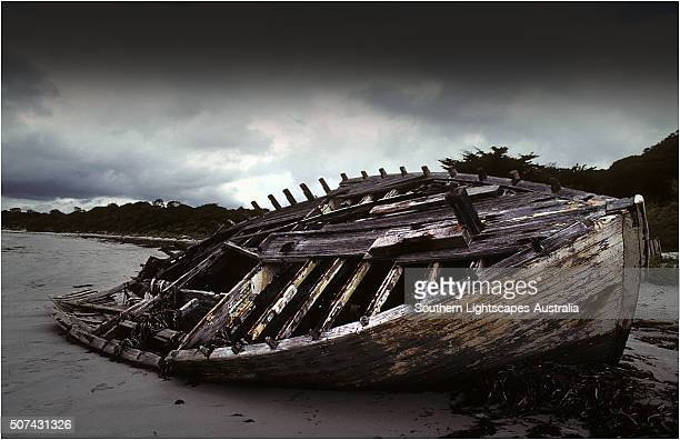 Wrecked fishing boat on the beach at Killiecrankie, Flinders Island, Bass Strait, Tasmania, Australia.