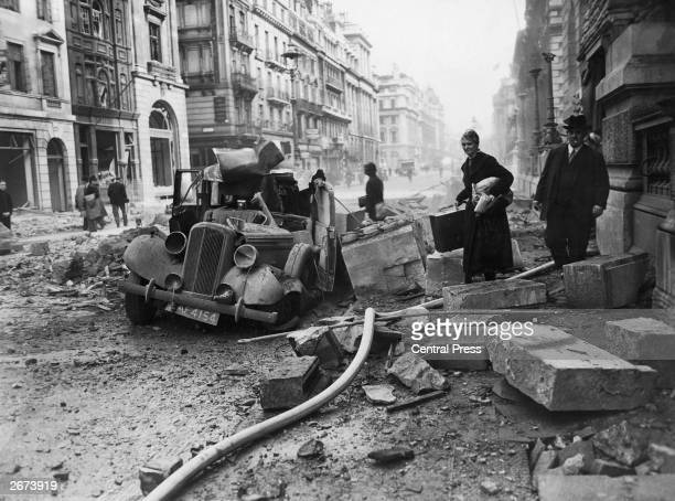 A wrecked Humber car on Pall Mall London after an air raid during the London Blitz 15th October 1940