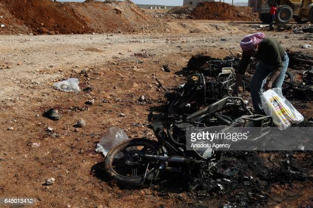 A wrecked motorcycle is seen after a car bomb attack by the Daesh terrorists aiming Free Syrian Army headquarter in Susian village located at...