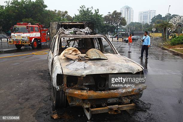 A wrecked police car is seen after the protests against Governor Basuki Ahok Tjahaja Purnama in front of the Presidential Palace in Jakarta Indonesia...