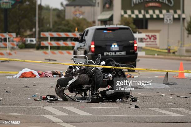 A wrecked police motorcycle lays on the scene after a suspected drunk driver crashed into a crowd of spectators during the Oklahoma State University...