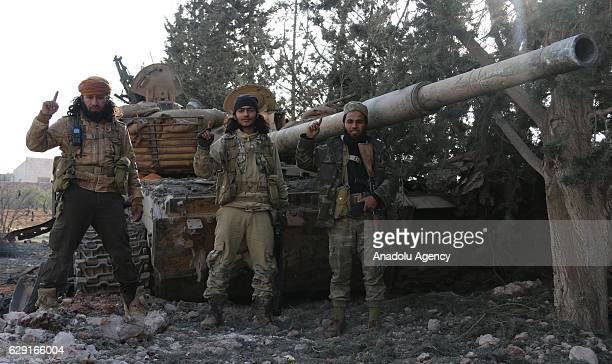 A wrecked tank belongs to Daesh terrorist is seen as members of Free Syrian Army attack Daesh terrorists' positions with heavy artillery and move...