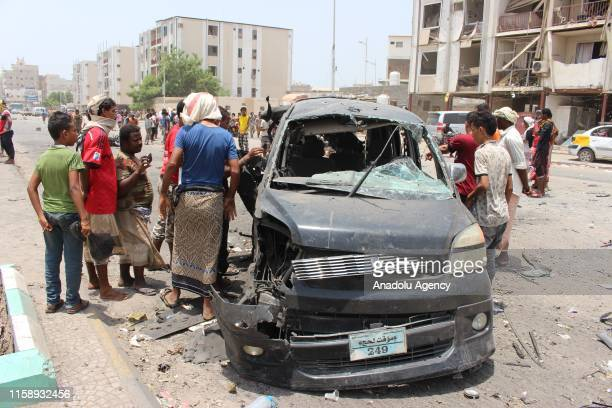 A wrecked vehicle is seen after a car bomb attack which was happened as conscripts were gathering for morning assembly to a police station in Aden...