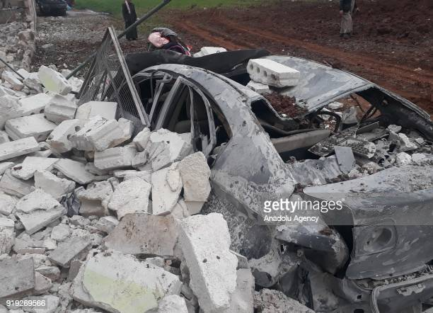 A wrecked vehicle is seen after an airstrike Hazzano town of Idlib Syria on February 17 2018
