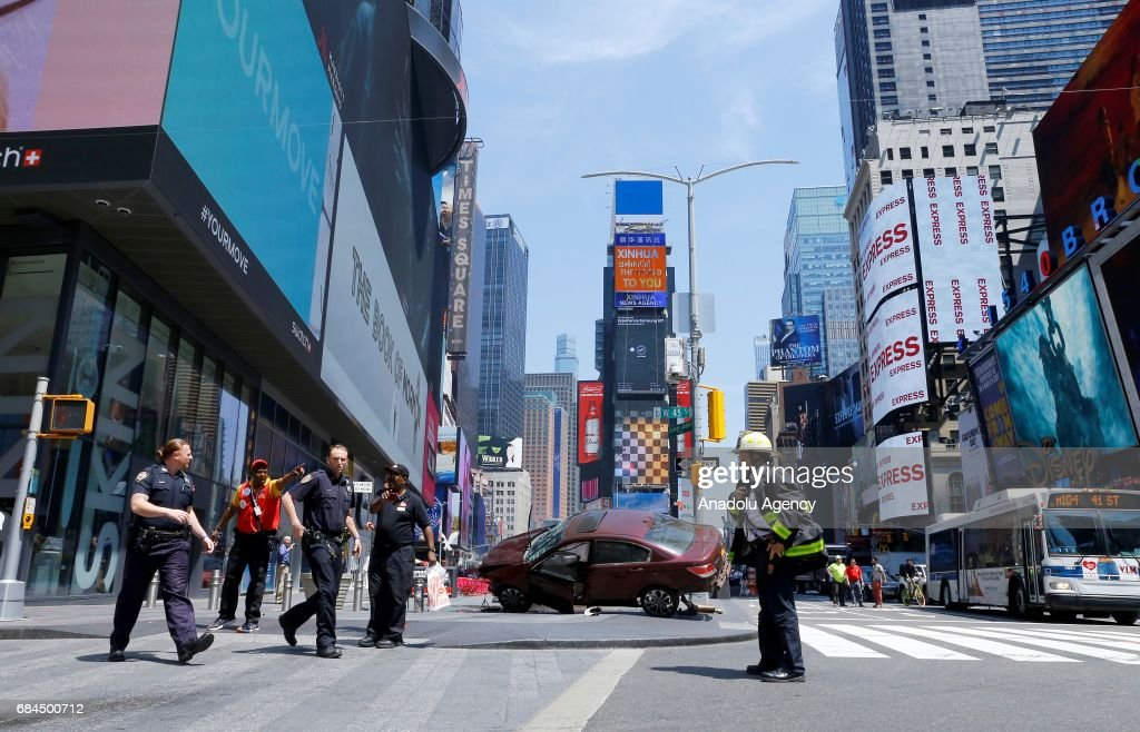 A wrecked vehicle is seen stopped after it plowed into pedestrians on a busy sidewalk on the corner of West 45th St. and Broadway at Times Square, New York, NY United States on May 18, 2017. Multiple pedestrians were struck Thursday by a speeding vehicle in the heart of New York City, according to reports. At least 13 people wounded.