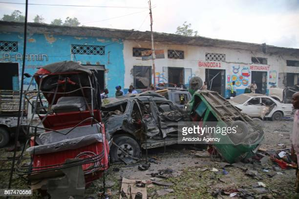 Wrecked vehicles are seen after a terror attack was carried out with a bombladen vehicle near Hotel Naso Hablod in Mogadishu Somalia on October 28...