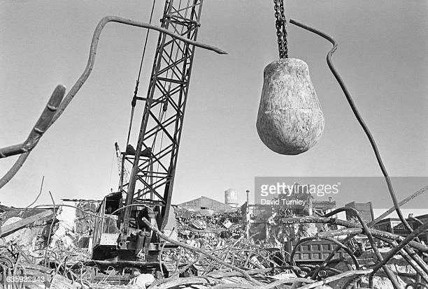 A wrecking ball hangs above a demolished building in Detroit's Poletown neighborhood which is being razed to make room for a General Motors plant