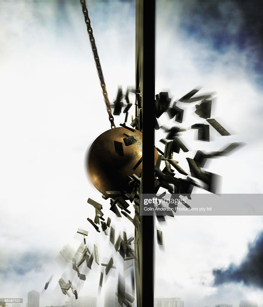 Wrecking ball hitting wall : Bildbanksbilder