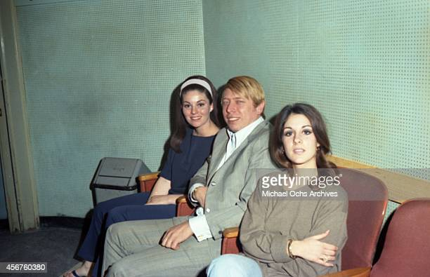 Wrecking crew pianist Don Randi and Dean Martin's daughters Deana Martin and Gail Martin in the studio in circa 1966 in Los Angeles California