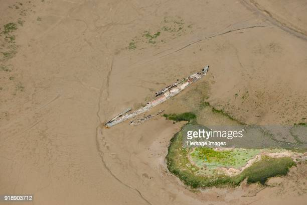 Wrecks at Stoke Saltings Kent 2015 Remains of a First World War UBoat and the sailing boat 'Swale' embedded in mud flats on the River Medway Artist...
