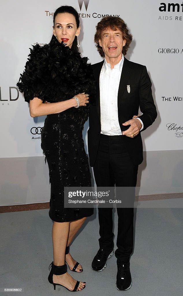 L'Wren Scott and Mick Jagger attend the '2010 amfAR's Cinema Against AIDS' Gala.