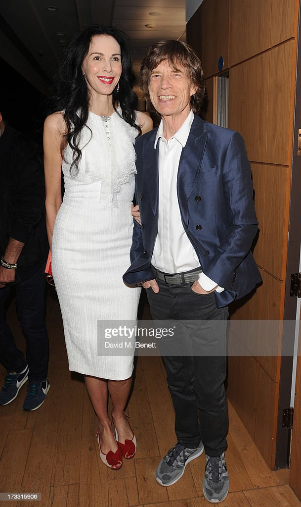 L'Wren Scott and Mick Jagger attend the private view of 'The Suzy Menkes Collection: In My Fashion' at Christie's on July 11, 2013 in London, England.